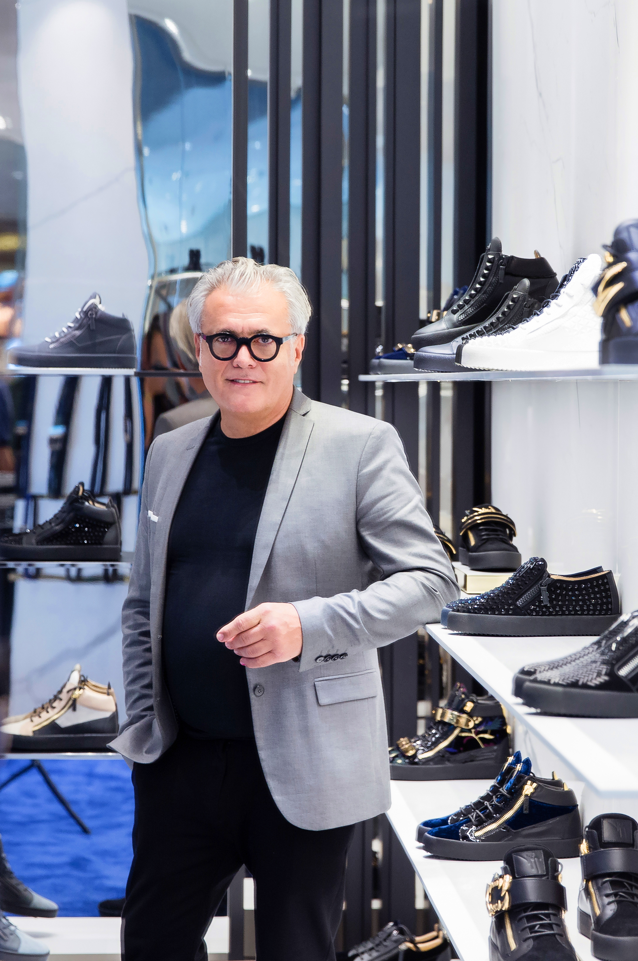 95d577624 Surrounded by sparkly shoes – his sparkly shoes – Giuseppe Zanotti wears a  neat black jacket. He has been taking pictures in his eponymous brand s  renovated ...